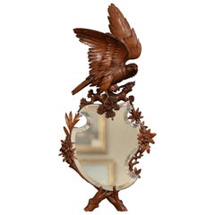 19th Century French Black Forest Carved Walnut Mirror with Eagle Sculpture
