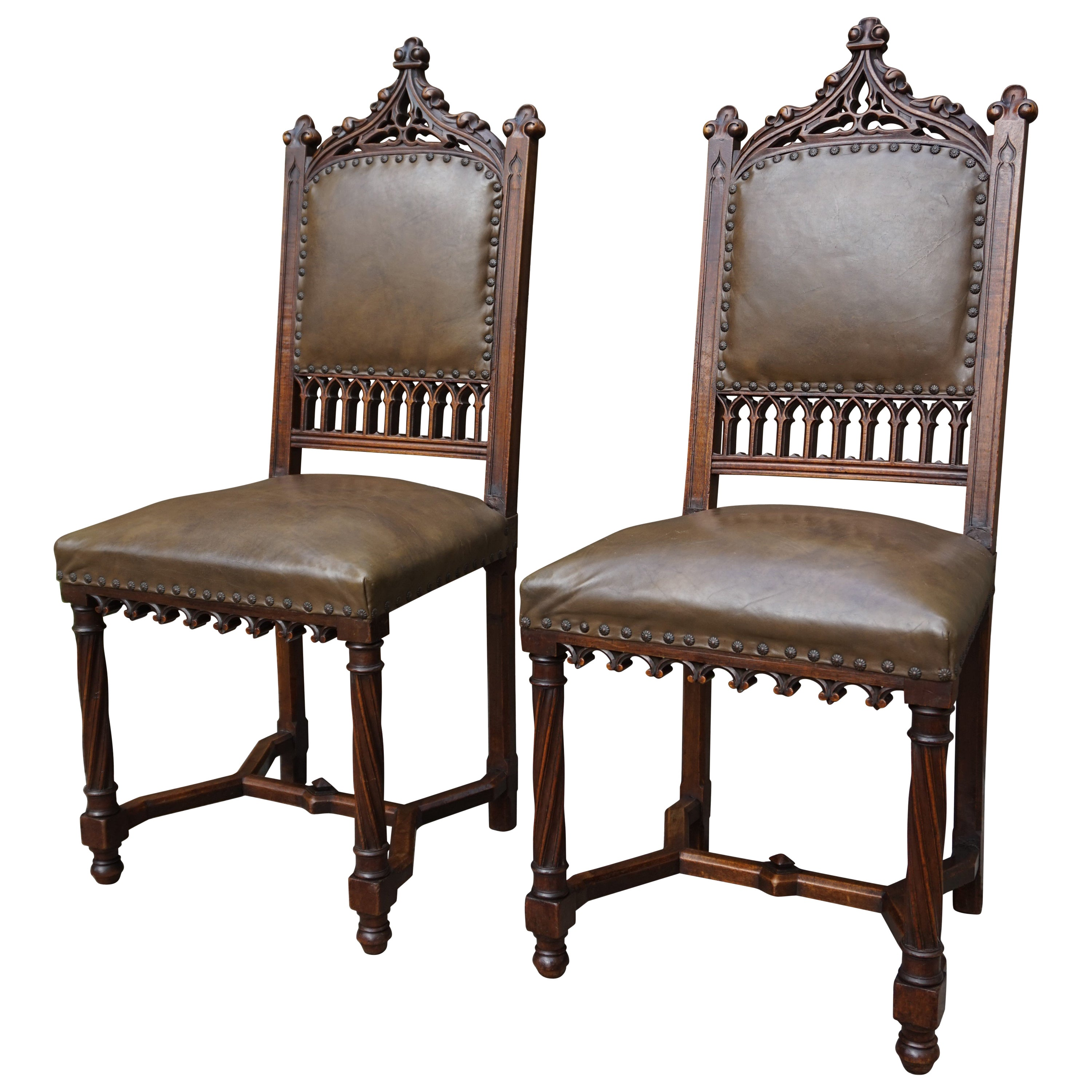 Pair of Hand Carved Solid Nutwood Gothic Revival Chairs with Leather Upholstery