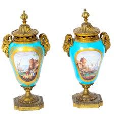 Pair of Bleu Celeste Sevres Porcelain Gilt Bronze Lidded Urns, 19th Century