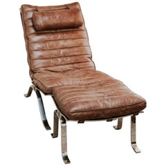 Ari Lounge Chair and Ottoman by Arne Norell, Leather and Steel