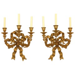Pair of French Louis XV Style Giltwood Bow Knot Back Wall Sconces