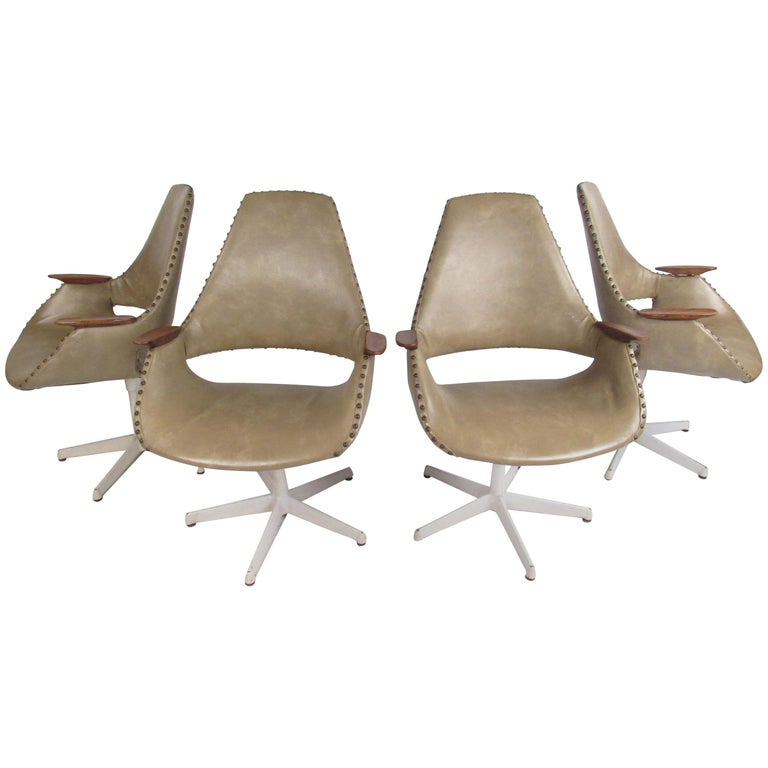 Set of Four Midcentury Swivel Armchairs For Sale