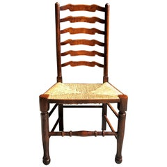 Set Of Eight English Oak Wavy Ladder Back Chairs With Rush