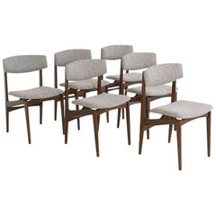 Midcentury Set of 6 Danish chairs in solid rosewood with new grey fabric