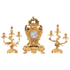 Richond, Rocaille style bronze mantel clock garniture, before 1873
