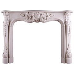 Heavily Carved French Louis XV Style Fireplace