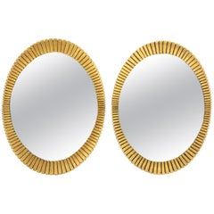 Two Hollywood Regency Francisco Hurtado Scalloped Giltwood Oval Mirrors, 1950s