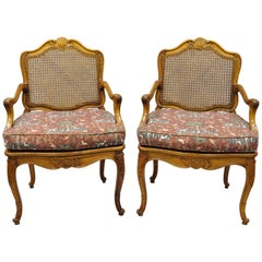 Pair of Vintage French Provincial Louis XV Style Cane Fauteuil Armchairs