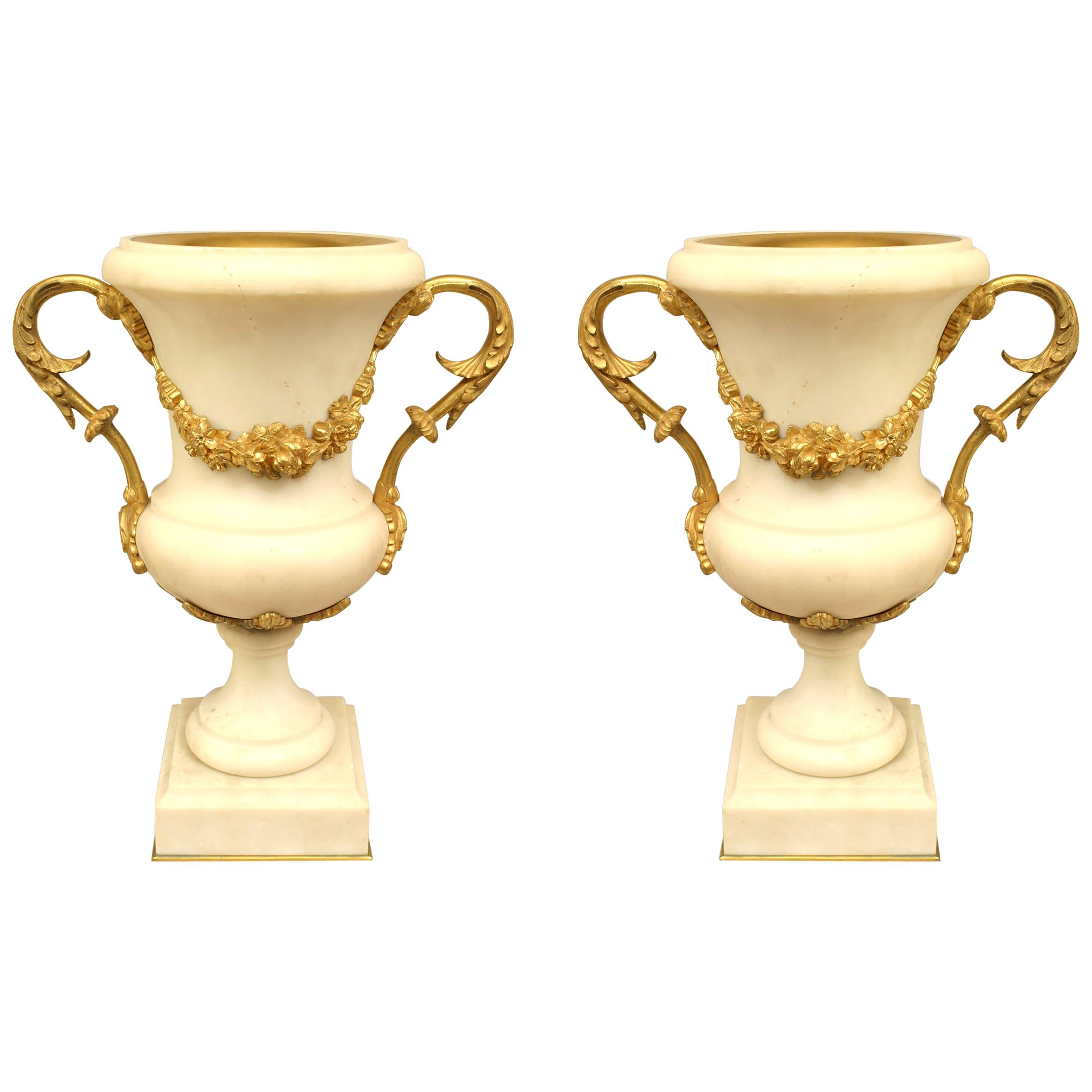 Pair of French Louis XVI Style Ormolu and White Marble Urns