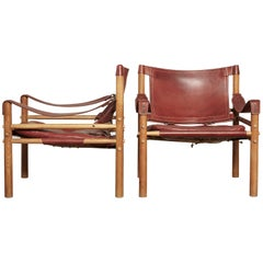 Pair of Red Arne Norell Sirocco Safari Chairs, Norell Mobel, Sweden, 1970s