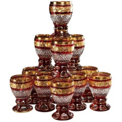 Set of 12 Ruby and Parcel-Gilt Bohemian Glasses, Late 19th Century
