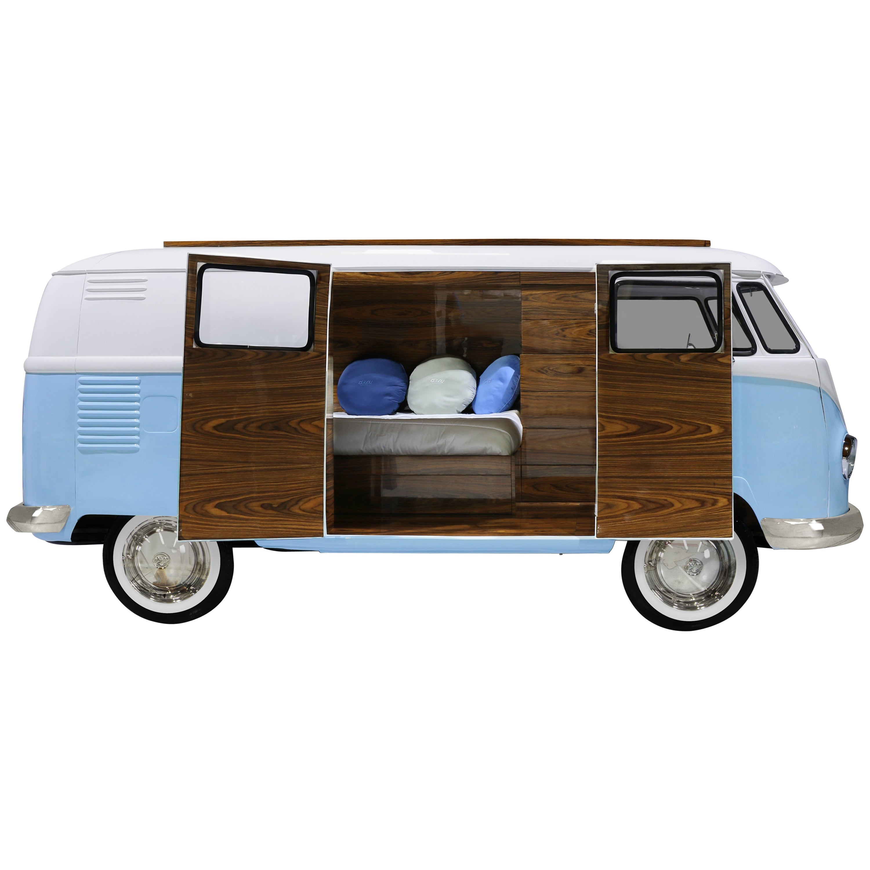 Bun Van Bed with Blue Exterior and Dark Wooden Doors