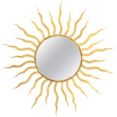 French 1950s Wrought Gilt Iron Sunburst Mirror in the Style of Gilbert Poillerat