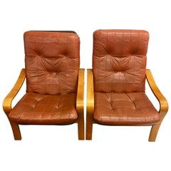 Pair of Matching Danish Modern Teak and Leather Lounge Chairs