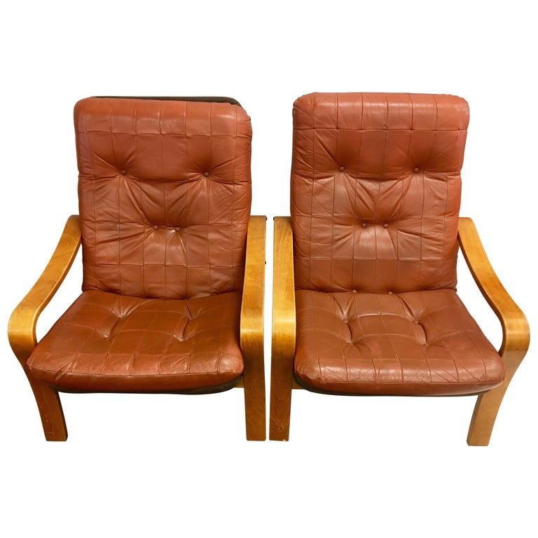 Pair of Danish Modern Teak and Tufted Leather Lounge Chairs For Sale