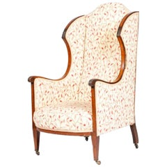 Late Victorian Mahogany Wing Armchair with Carved Frame and Ceramic Castors