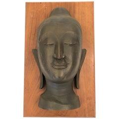 Striking Bronze Bust of Buddha on Walnut Plaque