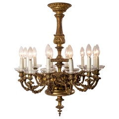 French Victorian Gilt Brass 12-Light Chandelier with Grotesque Motif