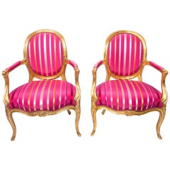 Pair of Louis XVI style magenta armchairs. French, early 20th Century.