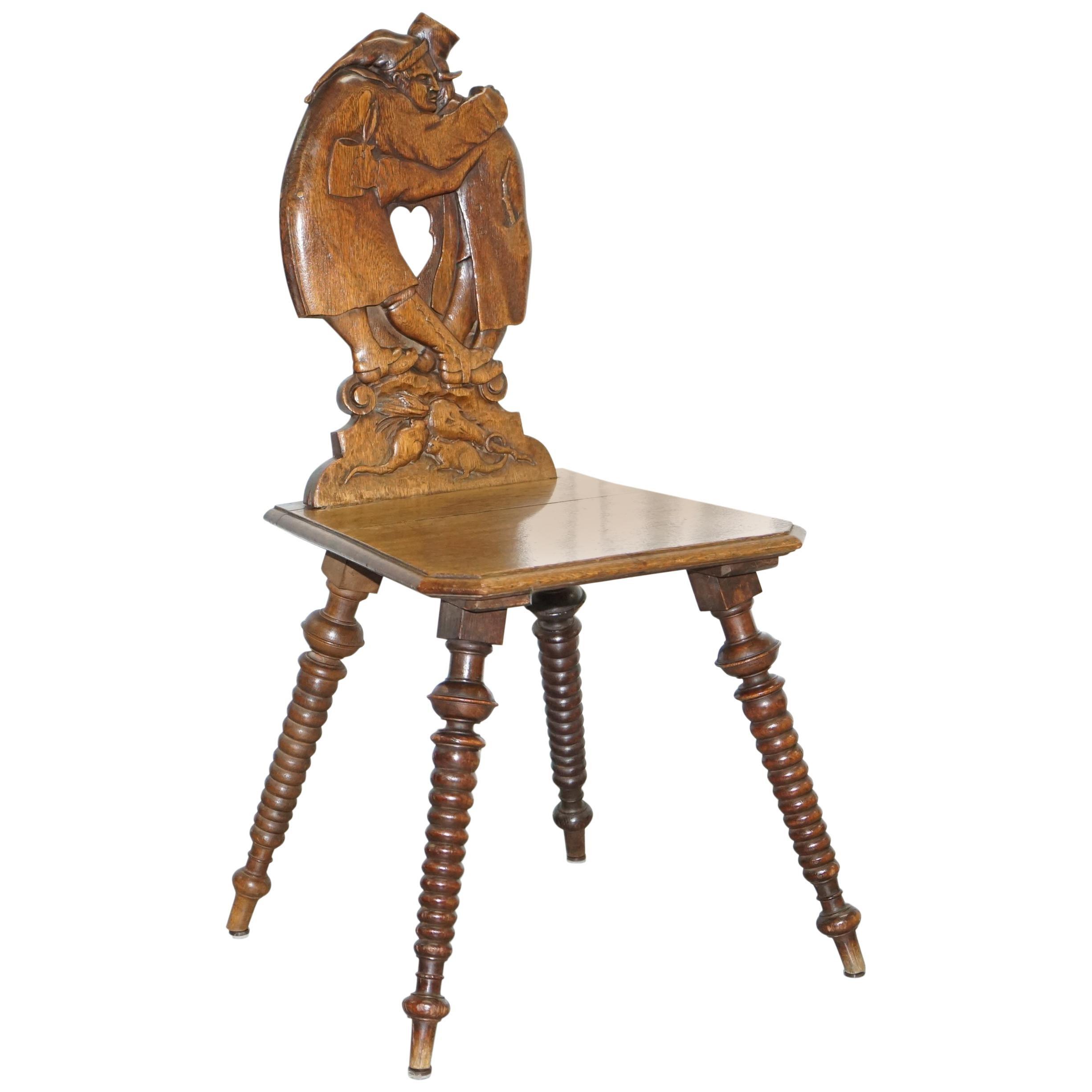 Black Forest Carve Oak Bobbin Hall Chair Depicting Two Friends Hugging Scrooge