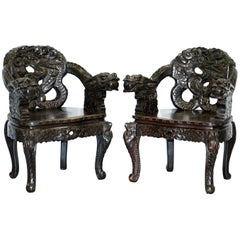 Pair of Black Qing Dynasty Carved Dragon and Lion Foo Dogs Armchairs, circa 1870