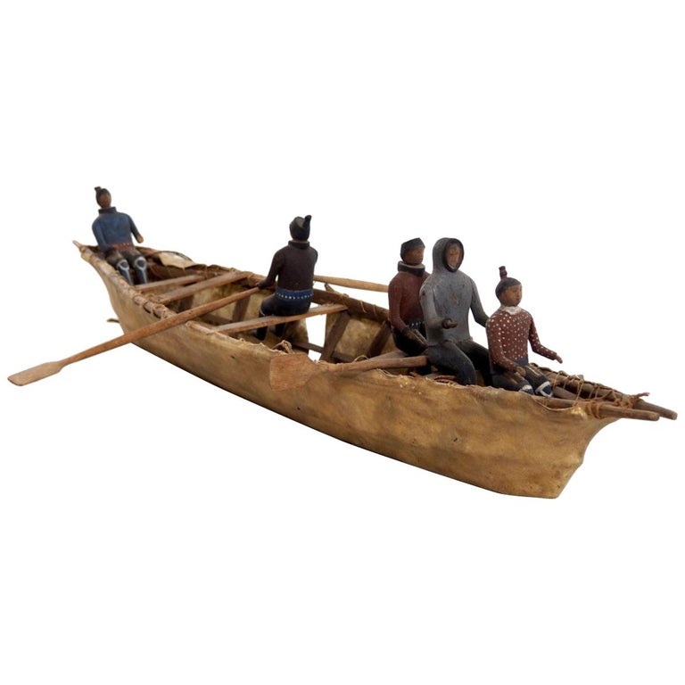 Important Eskimo Miniature Boat, with Carved and Original Painted Wood Figures