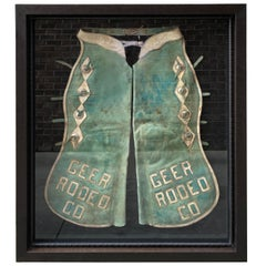Pair of Faded Turquoise Chaps with Silver Mounts with Geer Rodeo Company