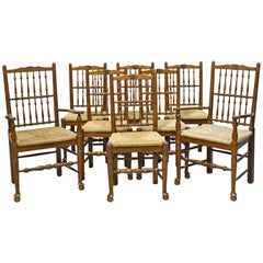 Set of 8 English Made Oak Dining Chairs with Rush Seats, circa 1990s