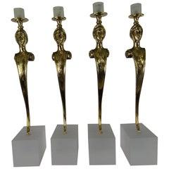 Set von vier des 20ten Jahrhunderts polierte Bronze Kerzenhalter