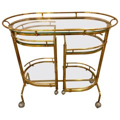 Hollywood Regency Brass and Glass Swivel Bar Cart