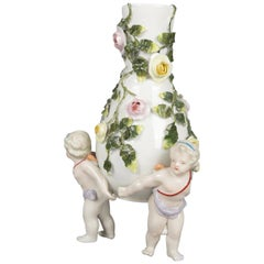 Antique German Meissen Porcelain Figural Cherub and Rose Bud Vase, circa 1890