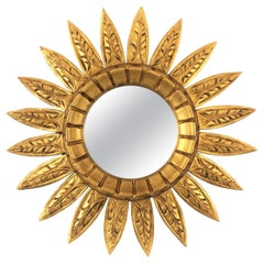 Spanish Mid-20th Century Carved Giltwood Sunflower Sunburst Mirror