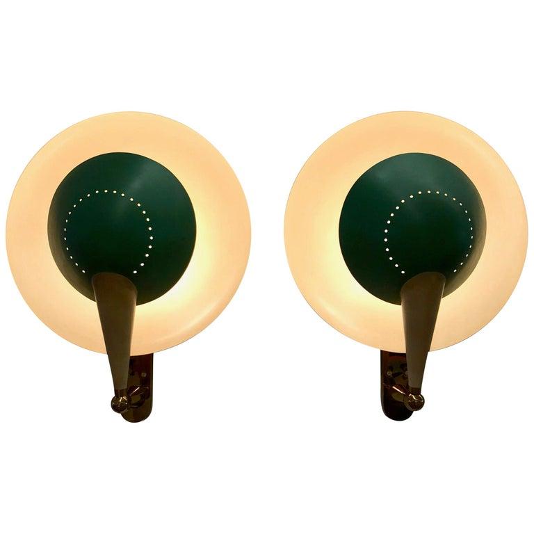 Stilnovo pair of Model No. B 4917 adjustable sconces, 1950s, offered by Tishu