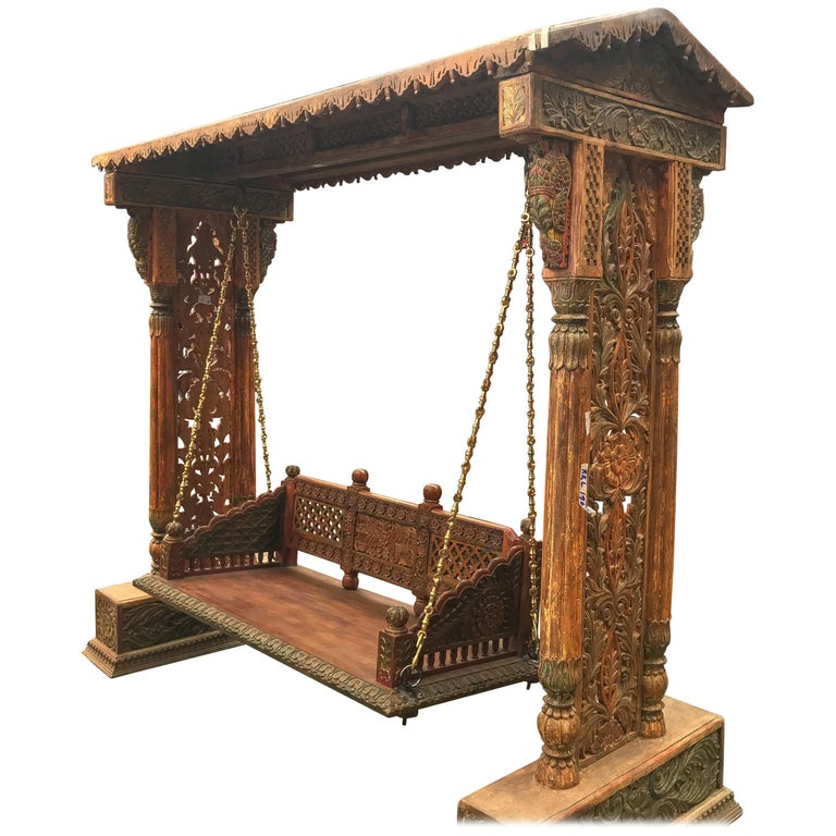 Indian carved and colored teakwood swing, 19th century