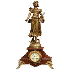 19th Century French Red Marble and Bronzed Spelter Mantel Clock after Guillemin