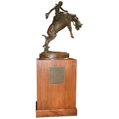 Grand Speed Sculpture of Cowboy and Horse