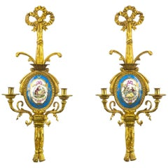 Pair of French Gilt Bronze and Sevres Sconces