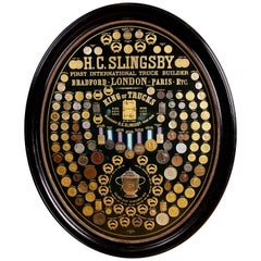 Display of Medals from H.C. Slingsby Truck Company, Set in Large Oval Frame