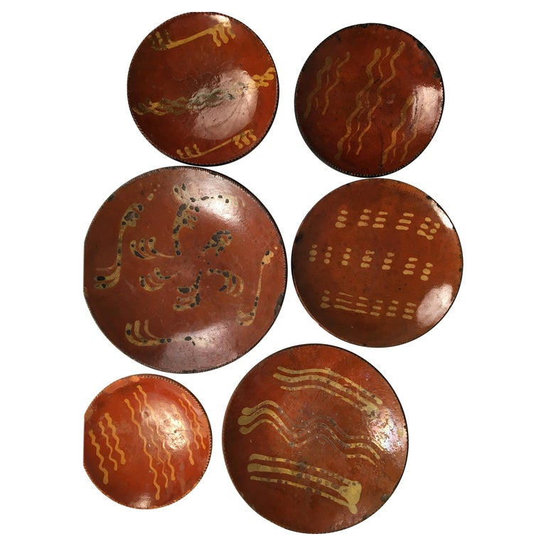 Collection of 6 Pennsylvania Redware Plates, 19th Century For Sale