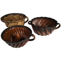 "Collection of 3 Pennsylvania Redware ""Turk's Head"" Cake Molds, 18th Century"