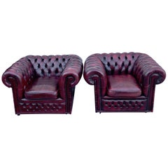 Pair of English Red Leather Chesterfield Club Chairs with Faux Bamboo Detail