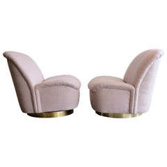 Pair of Directional Swivel Lounge Chairs in Pink with Brass Base
