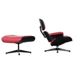 Vitra Charles Eames Lounge Chair und Ottoman von Vitra rot Leder, schwarze Schalen