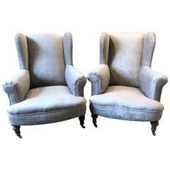 Pair of Low Wing Back Upholstered Armchairs