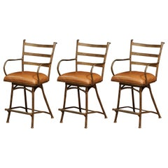 Set of Three French Rust Iron Swivel Stools with Brown Leather Seat