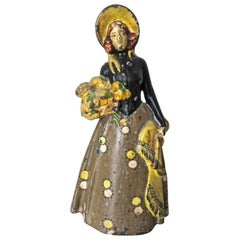 "Vintage Cast Iron Doorstop ""Lady With Flowers"", American, circa 1915"