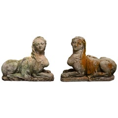 Pair of Cast Stone Egyptian Revival Sphinx Figures