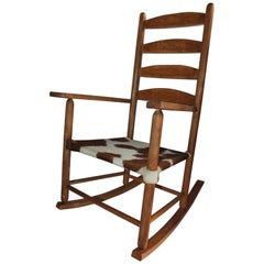Early 20th Century South West Rocking Chair in Cowhide Seat
