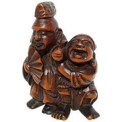 Meiji Period Japanese Two Street Entertainment Netsuke, 1880s