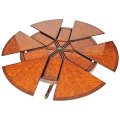 Flame Mahogany Segmented Circular Extending Table